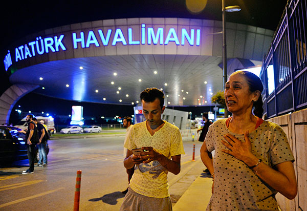 "<div class=""meta image-caption""><div class=""origin-logo origin-image none""><span>none</span></div><span class=""caption-text"">People gather on the entrance to Istanbul's Ataturk airport, early Wednesday, June 29, 2016. (Emrah Gurel/AP Photo)</span></div>"