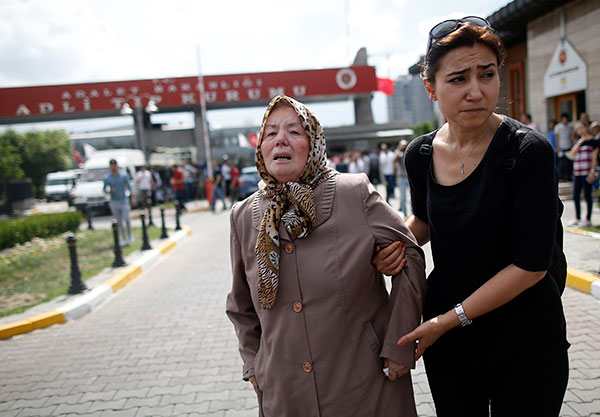 "<div class=""meta image-caption""><div class=""origin-logo origin-image none""><span>none</span></div><span class=""caption-text"">A family member helps Sacide Bugda, the mother of Abdulhakim Bugda, 24, one of victims, outside the Forensic Medical Center in Istanbul, Wednesday, June 29, 2016. (Emrah Gurel/AP Photo)</span></div>"
