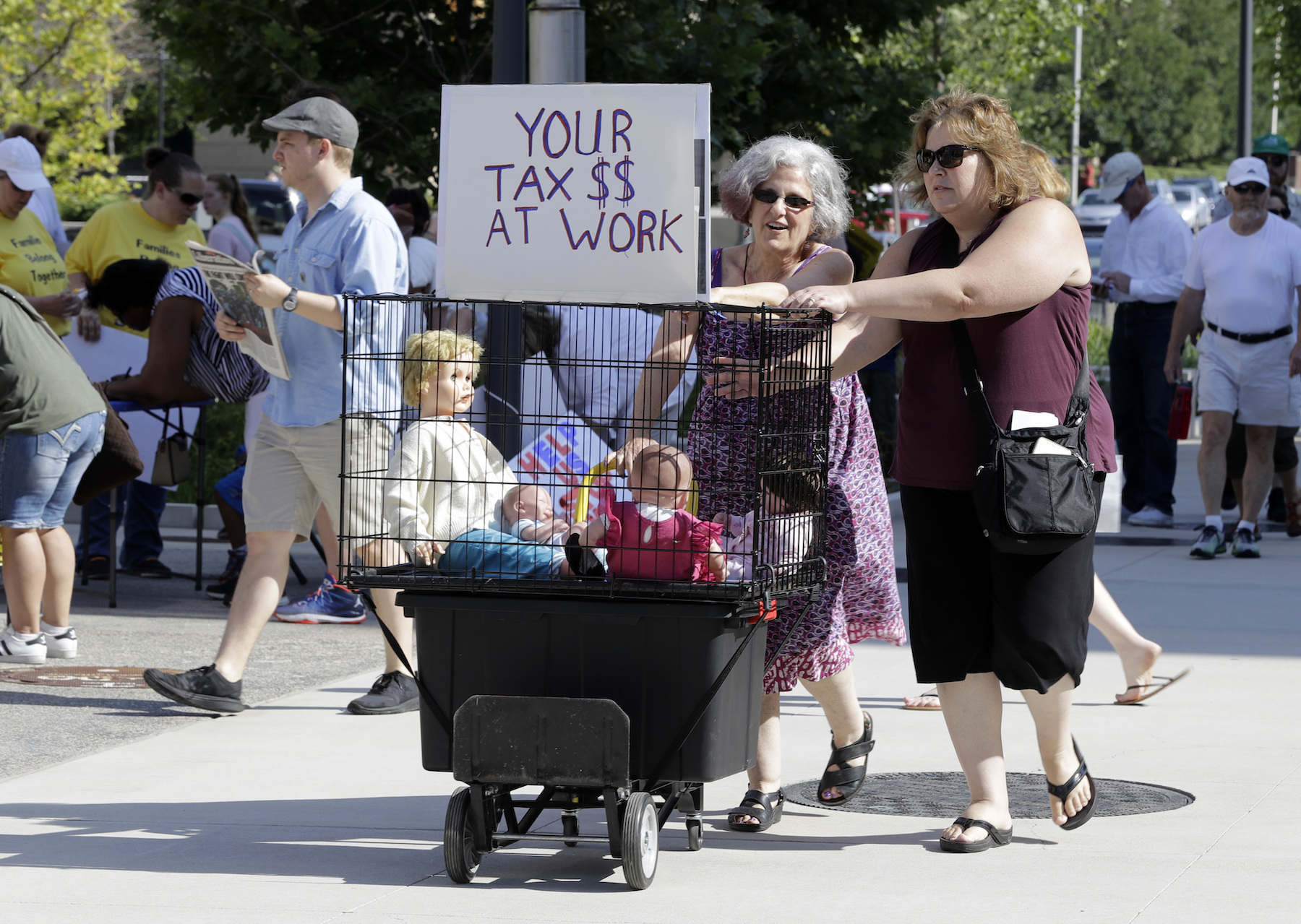 <div class='meta'><div class='origin-logo' data-origin='AP'></div><span class='caption-text' data-credit='AP Photo/Darron Cummings'>Deborah Langerman and Cara Hwang push a cart to a protest of the Trump administration's approach to illegal border crossings and separation of children from immigrant parents.</span></div>