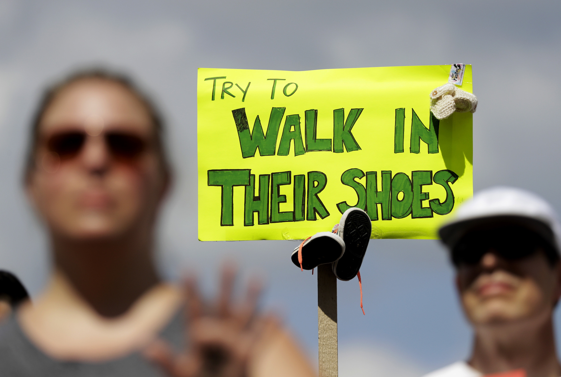 <div class='meta'><div class='origin-logo' data-origin='AP'></div><span class='caption-text' data-credit='AP Photo/Darron Cummings'>An activist holds a sign during a protest of the Trump administration's approach to illegal border crossings and separation of children from immigrant parents in Indianapolis.</span></div>