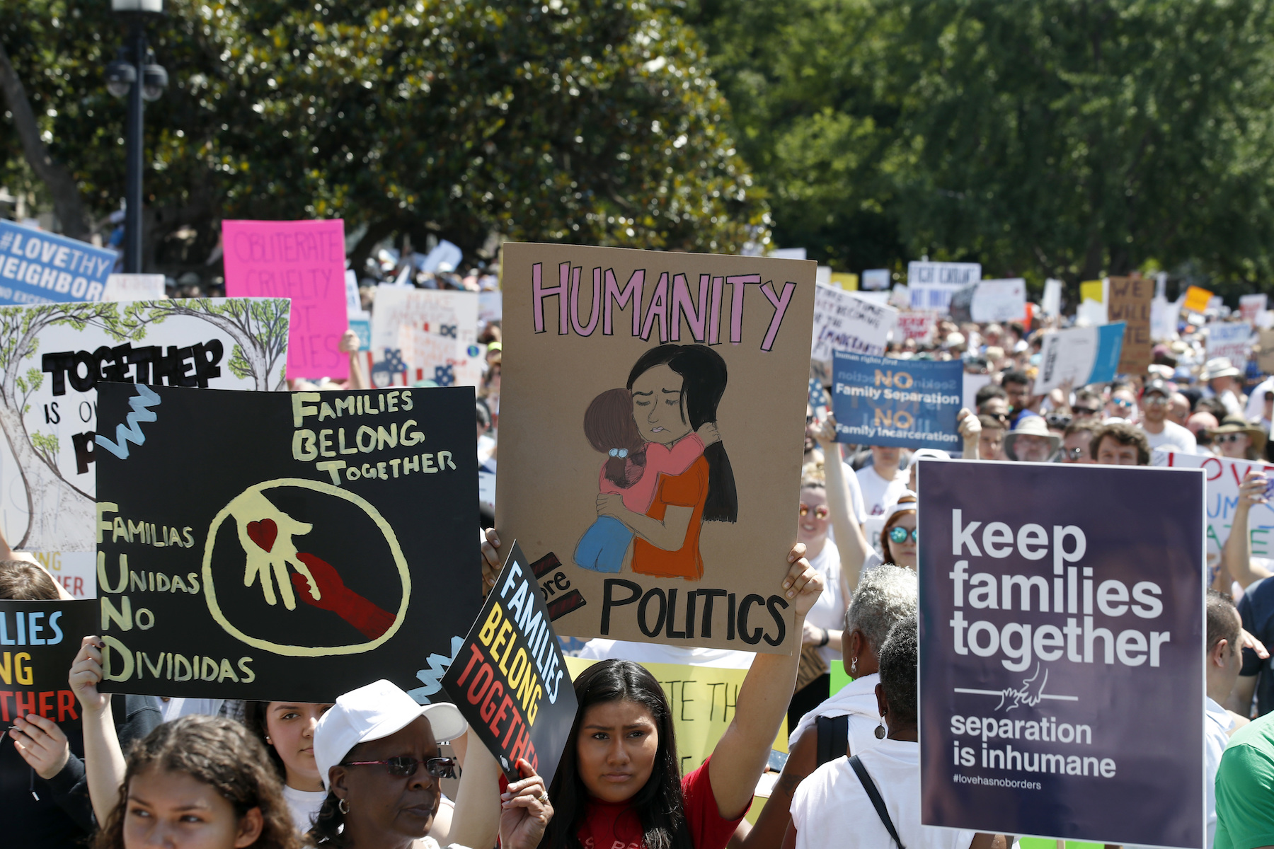 <div class='meta'><div class='origin-logo' data-origin='AP'></div><span class='caption-text' data-credit='AP Photo/Alex Brandon'>Activists protest the Trump administration's approach to illegal border crossings and separation of children from immigrant parents in Lafayette Square across from the White House.</span></div>