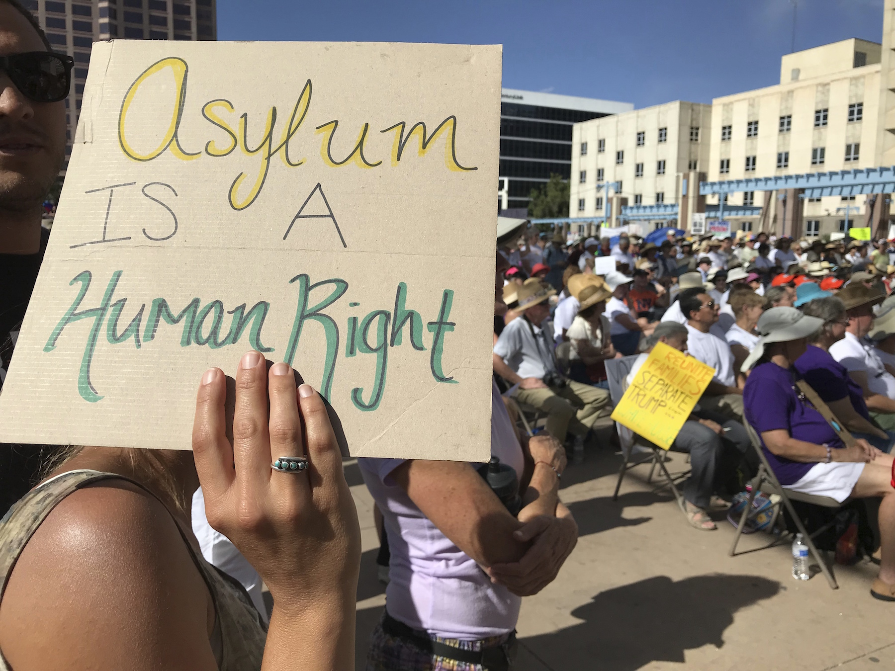 <div class='meta'><div class='origin-logo' data-origin='AP'></div><span class='caption-text' data-credit='AP Photo/Susan Montoya Bryan'>A protester holds up a sign as thousands gather for a demonstration on Civic Plaza in Albuquerque, N.M., on Saturday, June 30, 2018.</span></div>