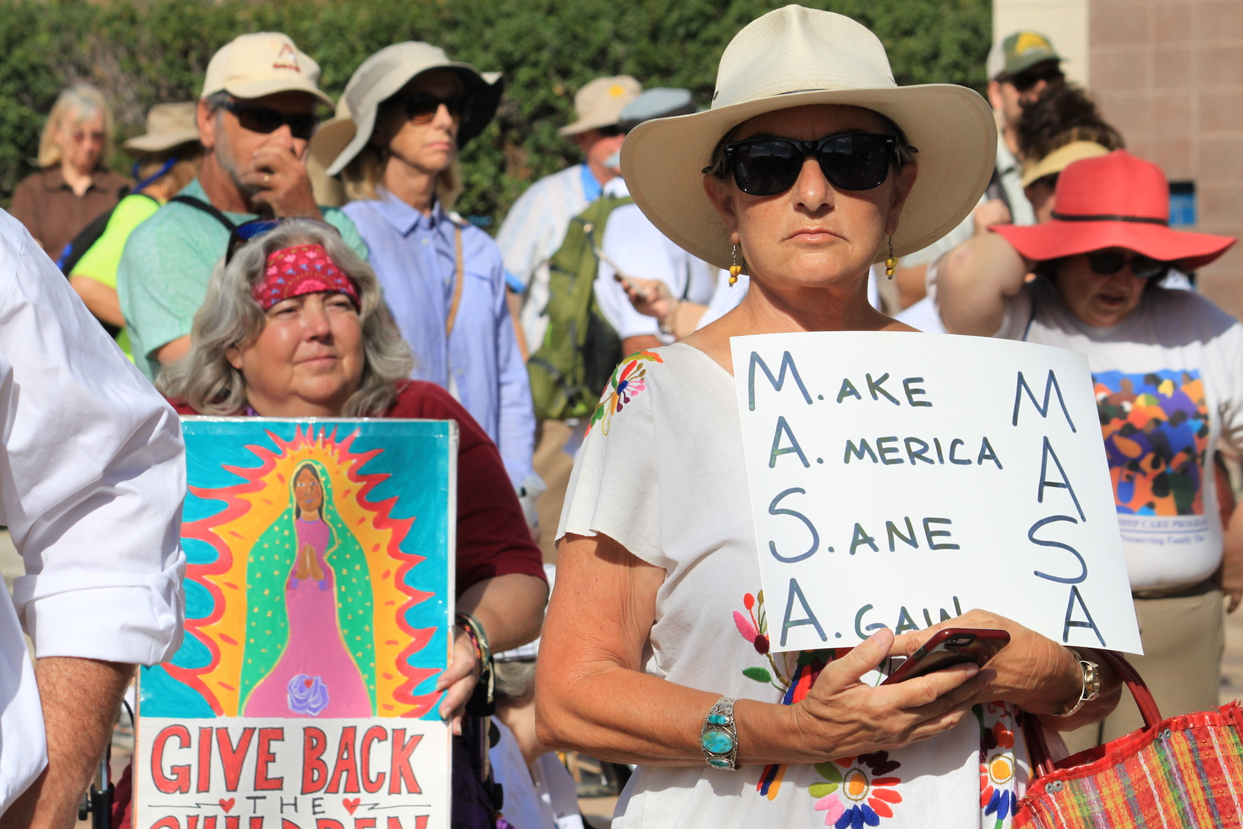 <div class='meta'><div class='origin-logo' data-origin='AP'></div><span class='caption-text' data-credit='AP Photo/Susan Montoya Bryan'>Paula Vallejos of Albuquerque listens to speakers during a protest on Civic Plaza in downtown Albuquerque, N.M., on Saturday, June 30, 2018.</span></div>