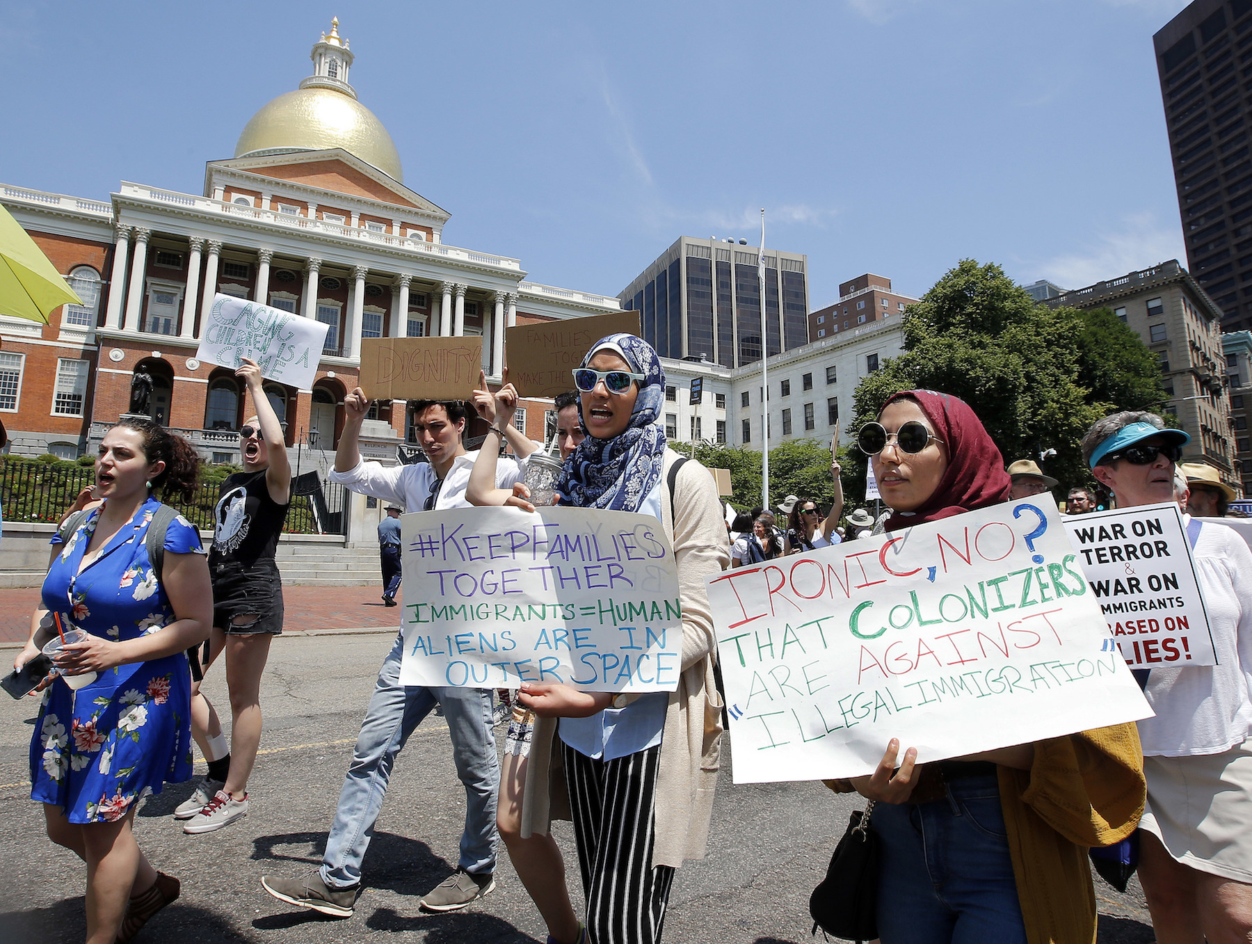 <div class='meta'><div class='origin-logo' data-origin='AP'></div><span class='caption-text' data-credit='AP Photo/Winslow Townson'>Lena Ismail, second from right, and Lamiya Khandaker, center, walk past the Massachusetts State House during a Rally Against Separation Saturday, June 30, 2018, in Boston.</span></div>