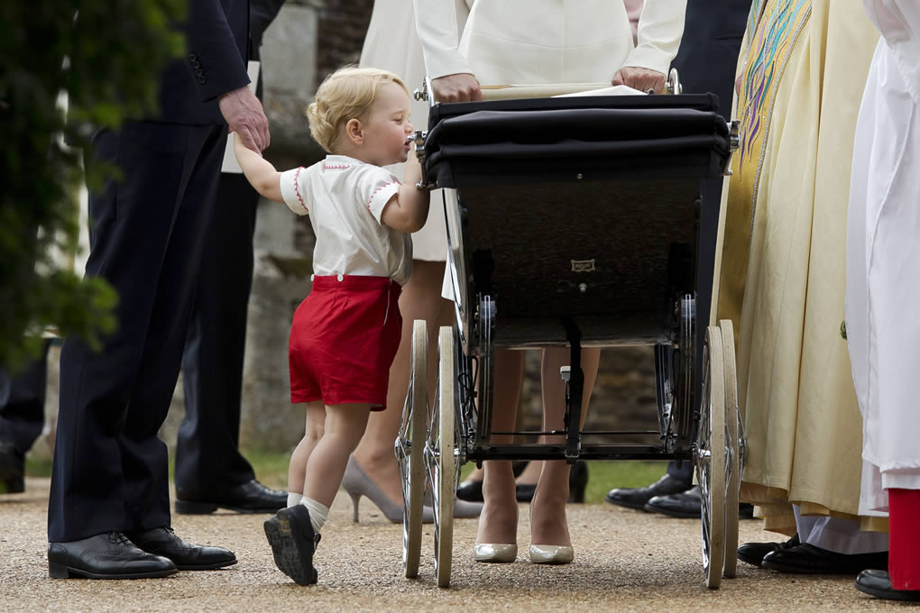 <div class='meta'><div class='origin-logo' data-origin='none'></div><span class='caption-text' data-credit='AP Photo/Matt Dunham, Pool'>Britain's Prince George peeks into the pram of Princess Charlotte flanked by his parents in Sandringham, England, July 5, 2015.</span></div>