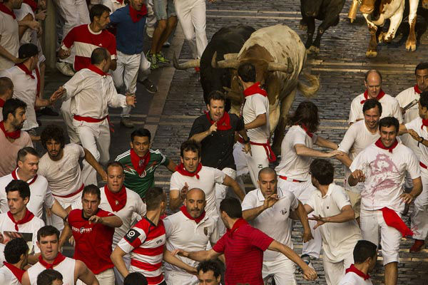 """<div class=""""meta image-caption""""><div class=""""origin-logo origin-image none""""><span>none</span></div><span class=""""caption-text"""">Jandilla fighting bulls and steers run after revelers during the running of the bulls, at the San Fermin festival, in Pamplona, Spain, Tuesday, July 7, 2015. (Photo/Andres Kudacki)</span></div>"""