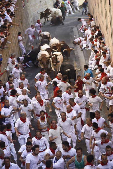 "<div class=""meta image-caption""><div class=""origin-logo origin-image none""><span>none</span></div><span class=""caption-text"">Participants run ahead of ''Jandilla'' fighting bulls from Santo Domingo street during the running of the bulls at the San Fermin Festival, in Pamplona, Spain (AP Photo/ Alvaro Barrientos)</span></div>"