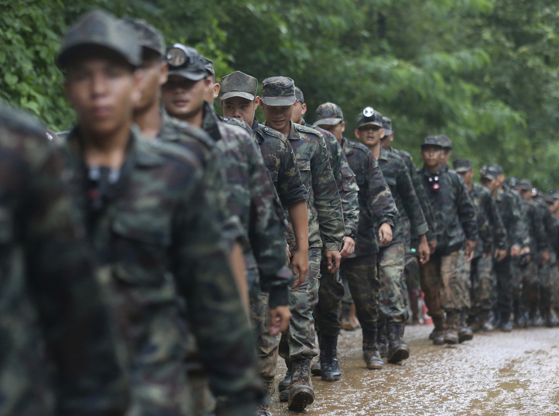 <div class='meta'><div class='origin-logo' data-origin='AP'></div><span class='caption-text' data-credit='AP Photo/Sakchai Lalit'>Thai soldiers line up to the cave area as they continue the search for a young soccer team and their coach believed to be missing in a large cave, Wednesday, June 27, 2018.</span></div>
