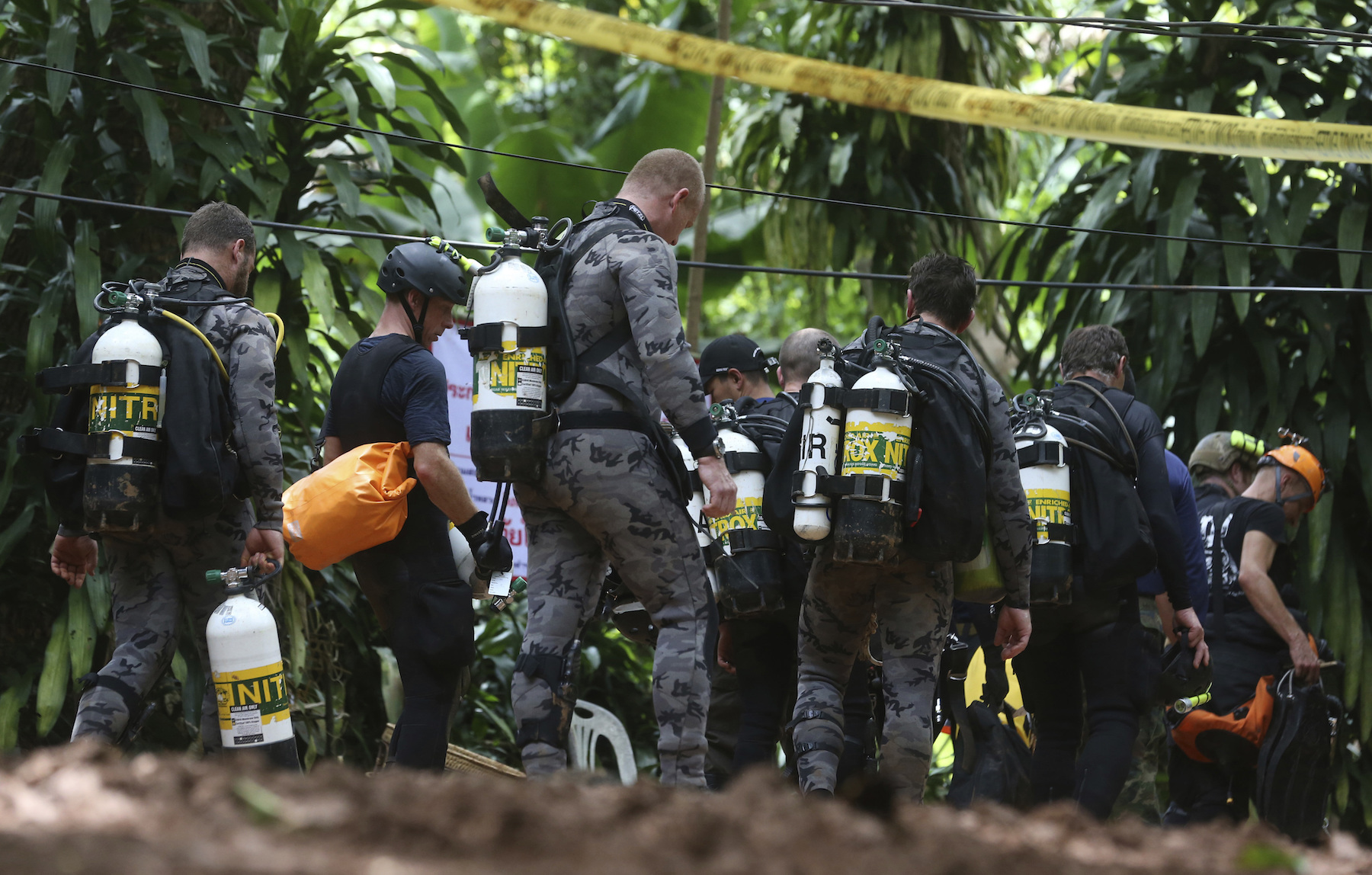<div class='meta'><div class='origin-logo' data-origin='AP'></div><span class='caption-text' data-credit='AP Photo/Sakchai Lalit'>International rescuers team prepare walk in of a cave where a young soccer team and their coach are believed to be missing, Thursday, July 5, 2018.</span></div>