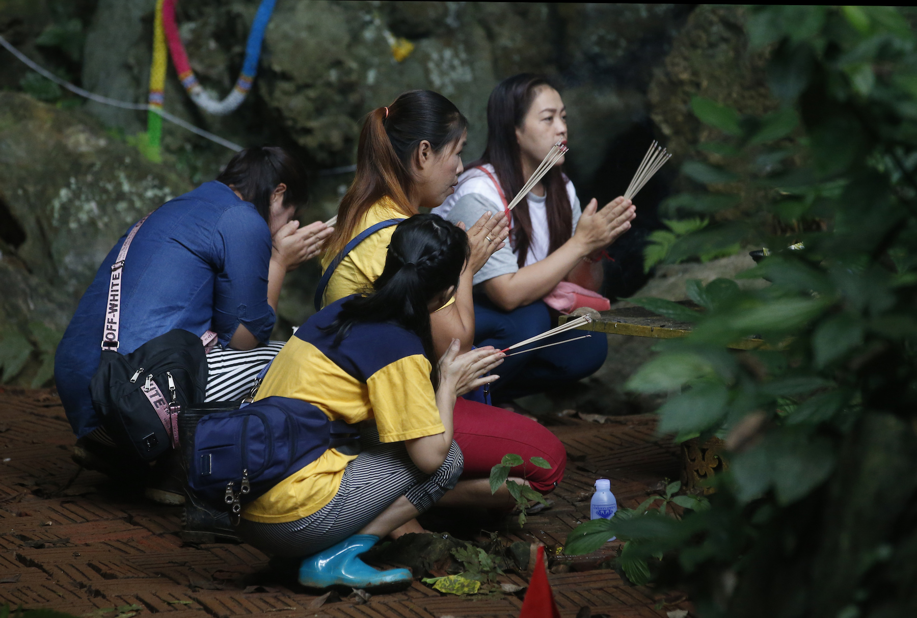 <div class='meta'><div class='origin-logo' data-origin='AP'></div><span class='caption-text' data-credit='AP Photo/Sakchai Lalit'>Family members pray near a cave where 12 boys and their soccer coach have been trapped since June 23, in Mae Sai, Chiang Rai province, in northern Thailand Saturday, July 7, 2018.</span></div>