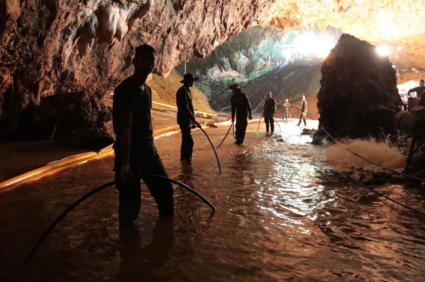 <div class='meta'><div class='origin-logo' data-origin='AP'></div><span class='caption-text' data-credit='Thai Navy via AP'>Thai rescue teams arrange a water pumping system at the entrance to a flooded cave complex where 12 boys and their soccer coach went missing in northern Thailand.</span></div>