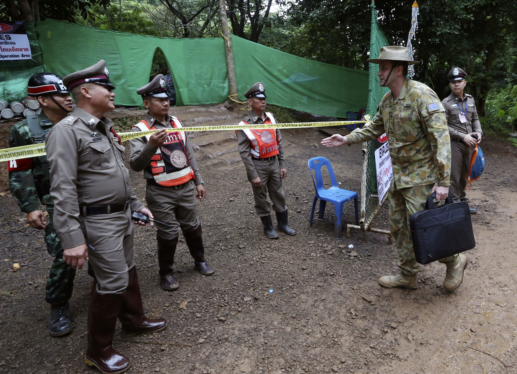 <div class='meta'><div class='origin-logo' data-origin='AP'></div><span class='caption-text' data-credit='AP Photo/Sakchai Lalit'>Australian Federal Police and Defense Force personnel arrive near a cave where 12 boys and their soccer coach have been trapped since June 23, in Mae Sai, Chiang Rai province.</span></div>