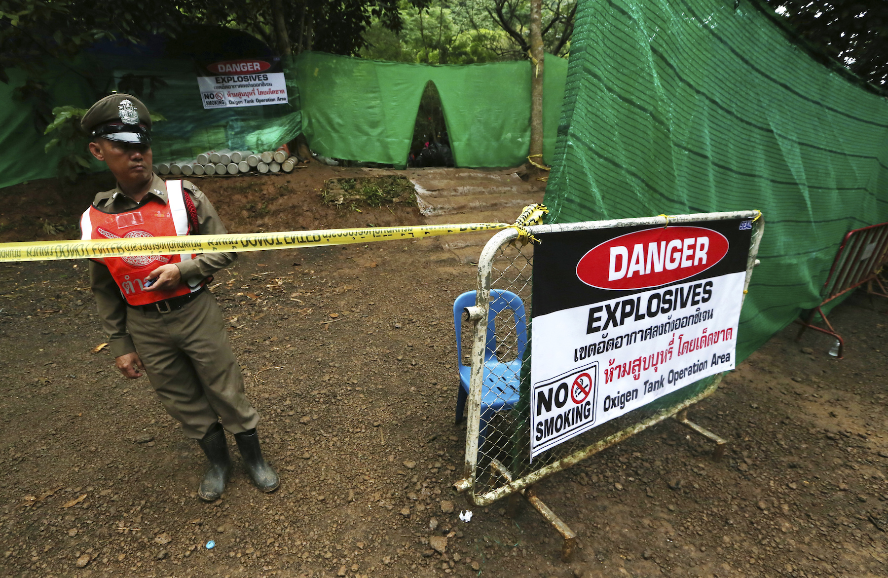 <div class='meta'><div class='origin-logo' data-origin='AP'></div><span class='caption-text' data-credit='AP Photo/Sakchai Lalit'>Thai police stand guard near a cave where 12 boys and their soccer coach have been trapped since June 23, in Mae Sai, Chiang Rai province, in northern Thailand.</span></div>
