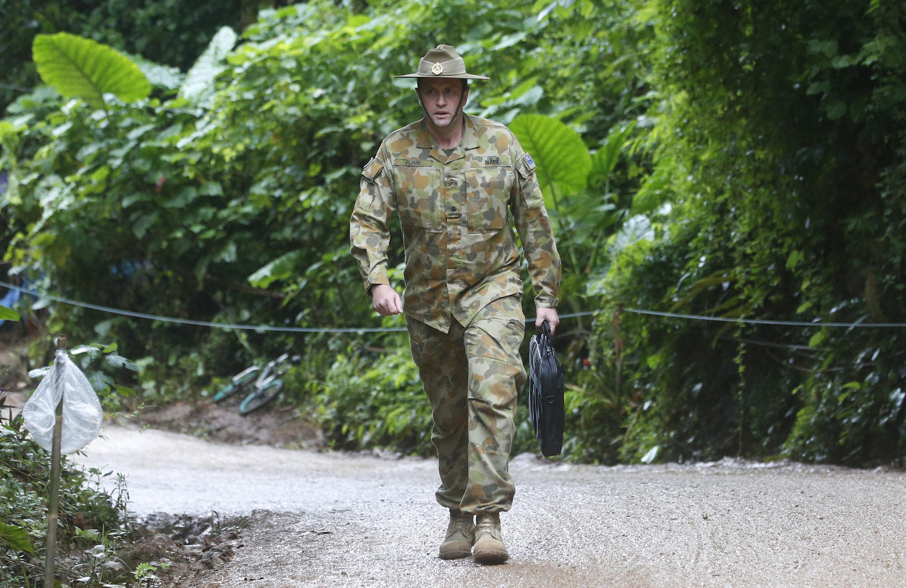 <div class='meta'><div class='origin-logo' data-origin='AP'></div><span class='caption-text' data-credit='AP Photo/Sakchai Lalit'>Australian Federal Police and Defense Force personnel arrive near a cave where 12 boys and their soccer coach have been trapped since June 23,.</span></div>