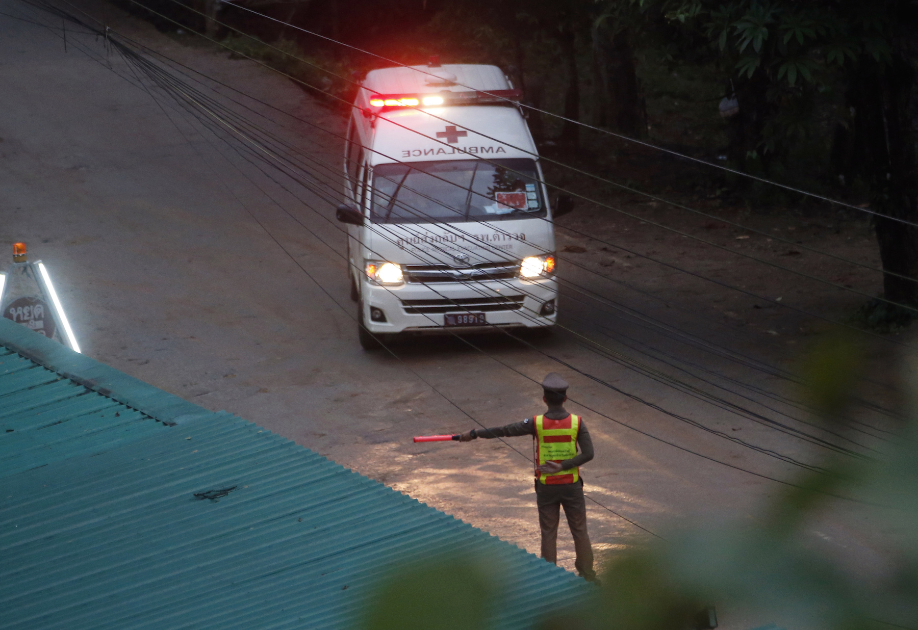 <div class='meta'><div class='origin-logo' data-origin='AP'></div><span class='caption-text' data-credit='AP Photo/Sakchai Lalit'>Two ambulances are seen leaving the cave in northern Thailand hours after operations began to rescue trapped youth soccer players.</span></div>