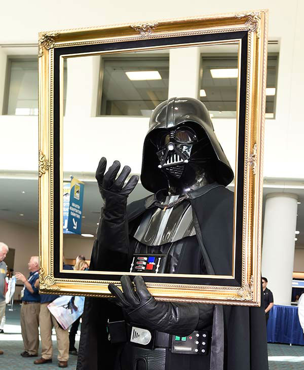"<div class=""meta image-caption""><div class=""origin-logo origin-image none""><span>none</span></div><span class=""caption-text"">A fan dressed as Star War's Darth Vader poses for a photo on the first day of the 2015 Comic-Con International (AP)</span></div>"