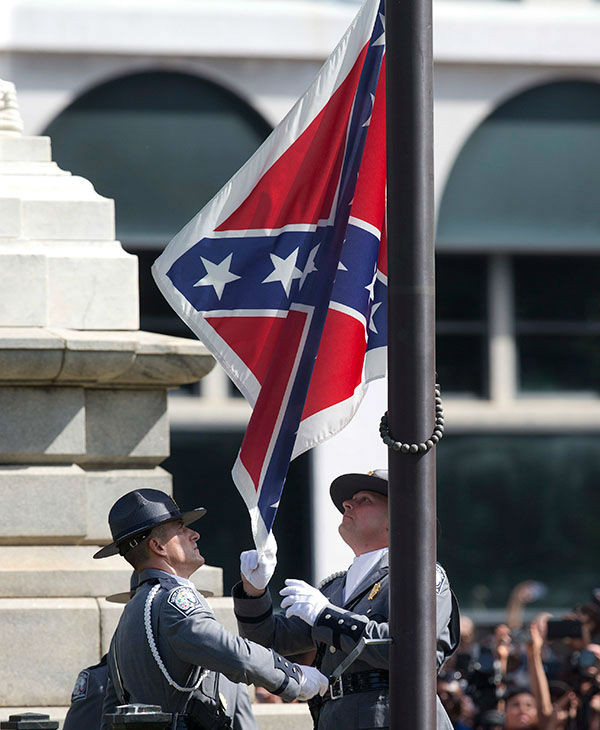 "<div class=""meta image-caption""><div class=""origin-logo origin-image none""><span>none</span></div><span class=""caption-text"">An honor guard from the South Carolina Highway patrol removes the Confederate battle flag from the Capitol grounds in Columbia, S.C. (AP)</span></div>"