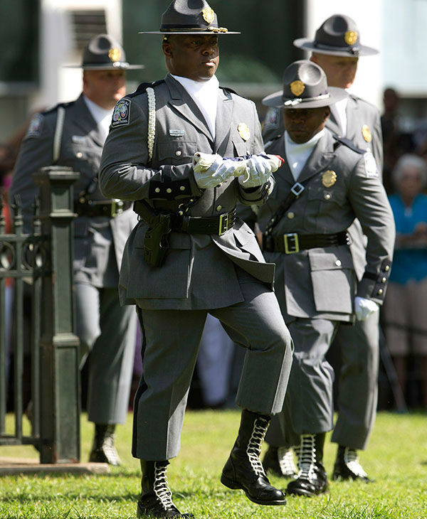 "<div class=""meta image-caption""><div class=""origin-logo origin-image none""><span>none</span></div><span class=""caption-text"">An honor guard from the South Carolina Highway patrol removes the Confederate battle flag from the Capitol grounds Friday, July 10, 2015, in Columbia, S.C. (AP)</span></div>"