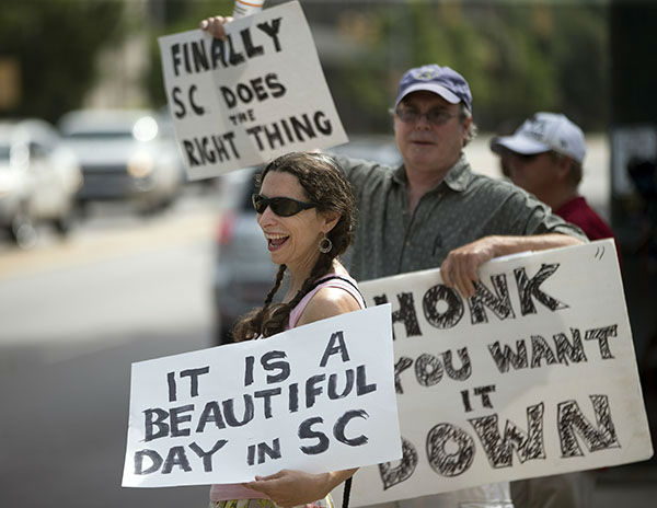 "<div class=""meta image-caption""><div class=""origin-logo origin-image none""><span>none</span></div><span class=""caption-text"">Leslie Minerd, of Columbia, S.C., holds a sign as she celebrates outside the South Carolina Statehouse, Thursday, July 9, 2015, in Columbia, S.C.  (AP)</span></div>"