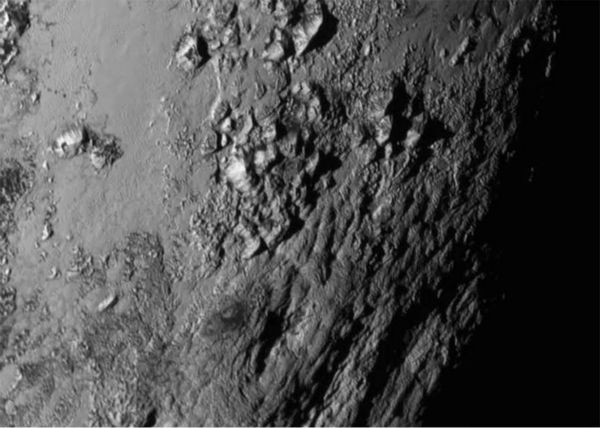 "<div class=""meta image-caption""><div class=""origin-logo origin-image none""><span>none</span></div><span class=""caption-text"">This Tuesday, July 14, 2015 image provided by NASA on Wednesday shows a region near Pluto's equator with a range of mountains captured by the New Horizons spacecraft. (NASA/JHUAPL/SwRI via AP)</span></div>"