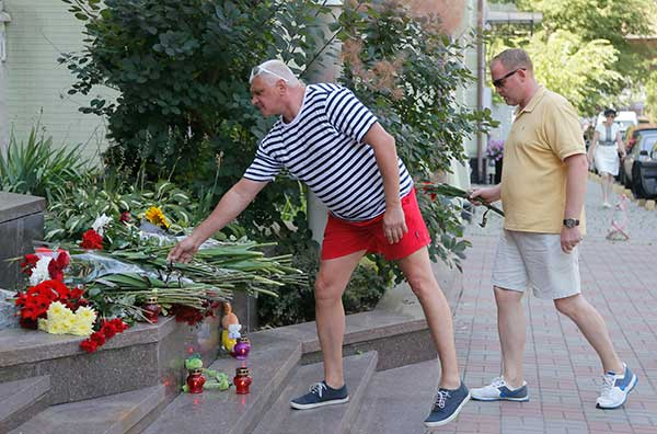 <div class='meta'><div class='origin-logo' data-origin='none'></div><span class='caption-text' data-credit='Efrem Lukatsky/AP Photo'>People lay flowers at the steps of the French Embassy in Kiev, Ukraine, Friday, July 15, 2016.</span></div>