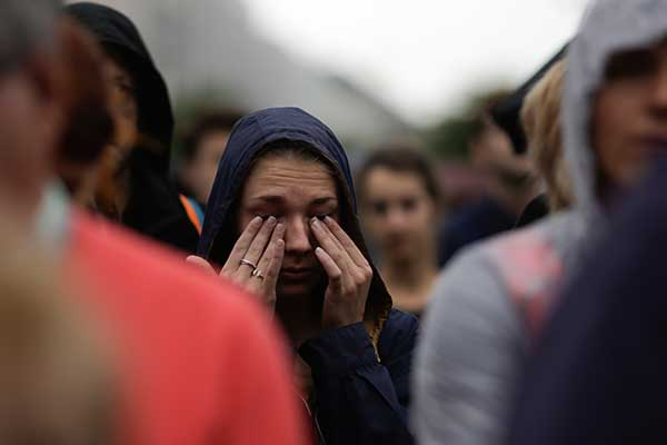 <div class='meta'><div class='origin-logo' data-origin='none'></div><span class='caption-text' data-credit='Markus Schreiber/AP Photo'>A woman weeps during an event to commemorate the victims of an attack in Nice near the French embassy in Berlin, Germany, Friday, July 15, 2016.</span></div>