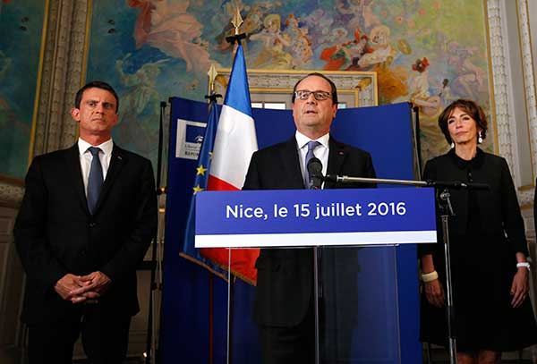 <div class='meta'><div class='origin-logo' data-origin='none'></div><span class='caption-text' data-credit='Eric Gaillard/AP Photo'>French President Francois Hollande, center, with Prime Minister Manuel Valls, left, and Minister of Health Marisol Touraine delivers a speech on Friday.</span></div>
