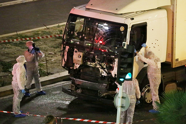<div class='meta'><div class='origin-logo' data-origin='none'></div><span class='caption-text' data-credit='Sasha Goldsmith via AP Photo'>Authorities investigate a truck after it plowed through Bastille Day revelers in the French resort city of Nice, France, Thursday, July 14, 2016.</span></div>