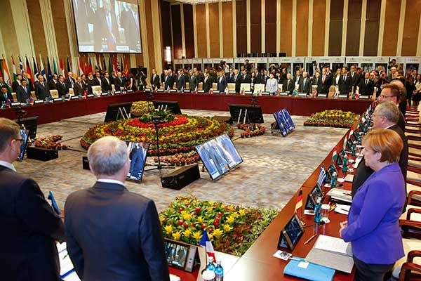 <div class='meta'><div class='origin-logo' data-origin='none'></div><span class='caption-text' data-credit='Damir Sagolj/Pool Photo via AP'>Leaders stand for a minute of silence before the opening session of the Asia-Europe Meeting (ASEM) summit in Ulaanbaa, Mongolia on Friday, July 15, 2016.</span></div>