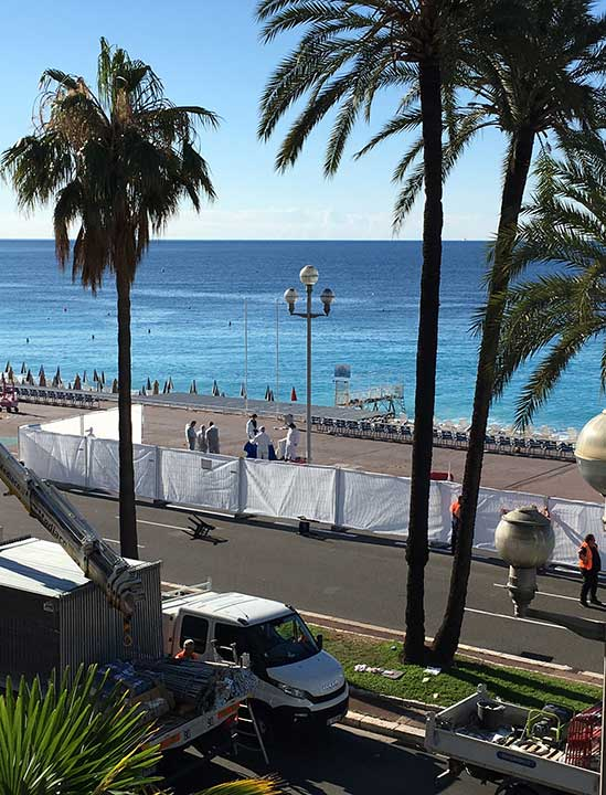 <div class='meta'><div class='origin-logo' data-origin='none'></div><span class='caption-text' data-credit='Sinan Baykent/AP Photo'>Forensic officials work on the beach next to the famed Promenade des Anglais, scene of the truck attack, in Nice, southern France, Friday, July 15, 2016.</span></div>