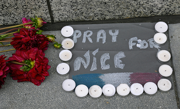 "<div class=""meta image-caption""><div class=""origin-logo origin-image none""><span>none</span></div><span class=""caption-text"">Flowers and candles are left following the attacks in Nice outside the entrance to the French Consulate Friday, July 15, 2016. (Eric Risberg/AP Photo)</span></div>"