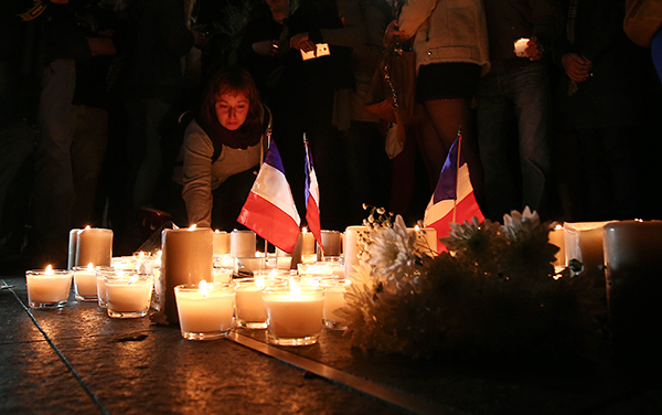 <div class='meta'><div class='origin-logo' data-origin='none'></div><span class='caption-text' data-credit='Rob Griffith/AP Photo'>A woman places a candle during a vigil to honor victims of the Bastille Day tragedy in Nice, France, in Sydney, Australia, Friday, July 15, 2016.</span></div>