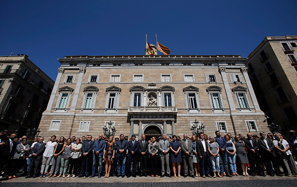 "<div class=""meta image-caption""><div class=""origin-logo origin-image none""><span>none</span></div><span class=""caption-text"">Catalan politics hold a minute of silence outside the Generalitat Palace, in Barcelona, Spain, Friday, July 15, 2016. (Manu Fernandez/AP Photo)</span></div>"