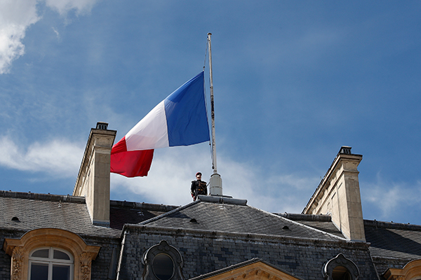 <div class='meta'><div class='origin-logo' data-origin='none'></div><span class='caption-text' data-credit='Thibault Camus/AP Photo'>A soldier stands next to a half staff French flag, at the Elysee palace in Paris, Friday, July 15, 2016.</span></div>