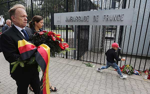 <div class='meta'><div class='origin-logo' data-origin='none'></div><span class='caption-text' data-credit='Czarek Sokolowski/AP Photo'>The German ambassador to Poland, Rolf Nikel, carries flowers to place at the French Embassy in Warsaw, Poland, on Friday July 15, 2016.</span></div>