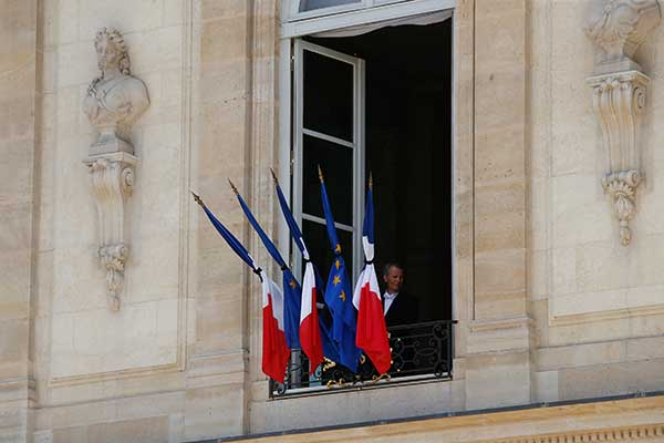 "<div class=""meta image-caption""><div class=""origin-logo origin-image none""><span>none</span></div><span class=""caption-text"">A man stands next to a half staff French flags, at the Elysee palace in Paris, Friday, July 15, 2016. (Thibault Camus/AP Photo)</span></div>"