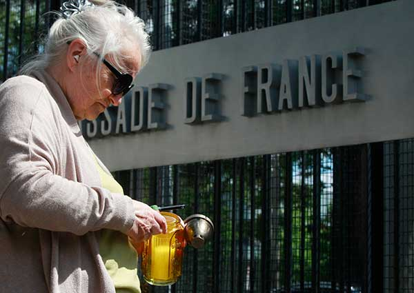 <div class='meta'><div class='origin-logo' data-origin='none'></div><span class='caption-text' data-credit='Czarek Sokolowski/AP Photo'>A woman lights a candle in honor of those slain in an attack in Nice at the French Embassy in Warsaw, Poland, on Friday July 15, 2016.</span></div>