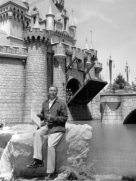 "<div class=""meta image-caption""><div class=""origin-logo origin-image none""><span>none</span></div><span class=""caption-text"">Walt Disney sits on a rock in front of the Sleeping Beauty Castle in the Fantasyland section of Disneyland on opening day of the amusement theme park in Anaheim, Calif. (Photo/AP)</span></div>"