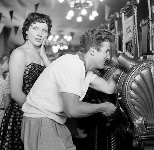 "<div class=""meta image-caption""><div class=""origin-logo origin-image none""><span>none</span></div><span class=""caption-text"">Actor Steve Rowland and actress Kathleen Case pose as they play arcade movies during the opening day of Disneyland in Anaheim, Calif. (Earl Leaf/Michael Ochs Archives/Getty)</span></div>"