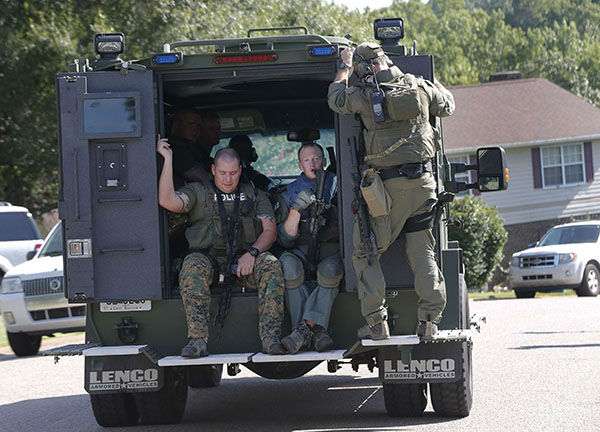 "<div class=""meta image-caption""><div class=""origin-logo origin-image none""><span>none</span></div><span class=""caption-text"">Members of a SWAT team sit on the back of a vehicle in Hixson, Tenn., Thursday, July 16, 2015.  (AP)</span></div>"