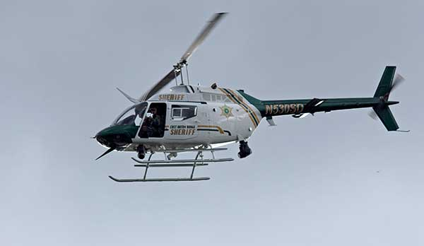 <div class='meta'><div class='origin-logo' data-origin='none'></div><span class='caption-text' data-credit='Max Becherer/AP Photo'>An East Baton Rouge Sheriff's Department helicopter circles the area over Airline Highway after police were shot in Baton Rouge, La., Sunday, July 17, 2016.</span></div>