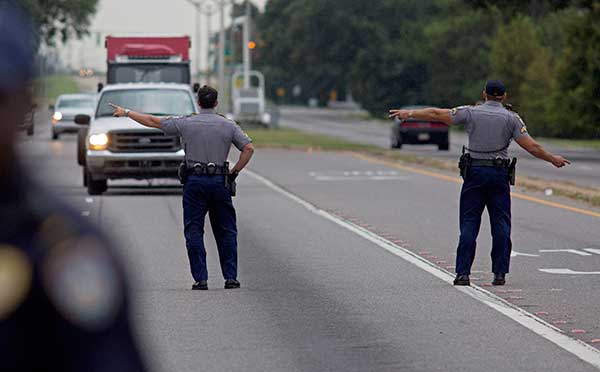 <div class='meta'><div class='origin-logo' data-origin='none'></div><span class='caption-text' data-credit='Max Becherer/AP Photo'>State Police block direct traffic off Airline Highway after Baton Rouge police were shot in Baton Rouge, La., on Sunday, July 17, 2016.</span></div>