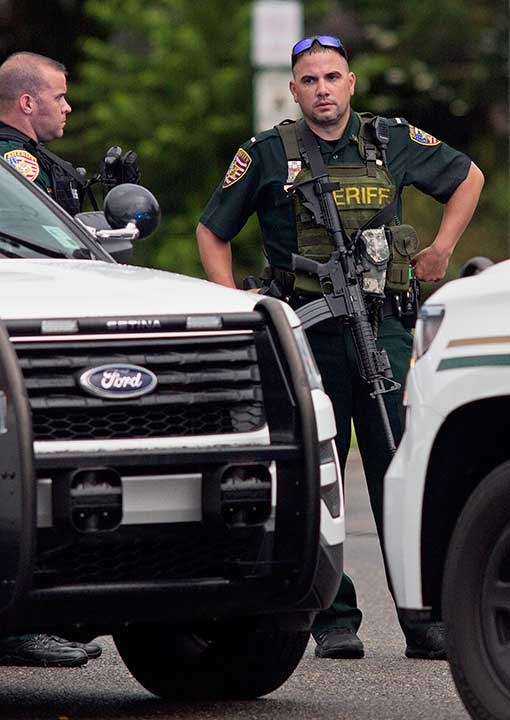 <div class='meta'><div class='origin-logo' data-origin='none'></div><span class='caption-text' data-credit='Max Becherer/AP Photo'>East Baton Rouge Sheriff's deputies man a road block on Airline Highway after police were shot in Baton Rouge, La., Sunday, July 17, 2016.</span></div>