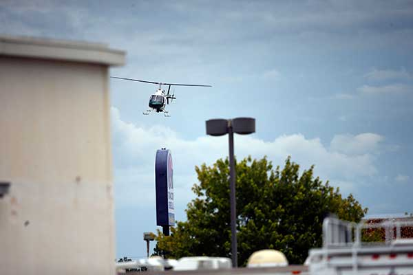 <div class='meta'><div class='origin-logo' data-origin='none'></div><span class='caption-text' data-credit='Gerald Herbert/AP Photo'>A law enforcement helicopter flies over the crime scene where Baton Rouge police were shot, in Baton Rouge, La., Sunday, July 17, 2016.</span></div>