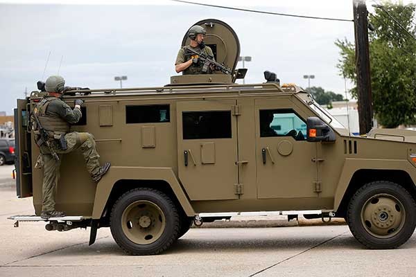 <div class='meta'><div class='origin-logo' data-origin='none'></div><span class='caption-text' data-credit='Gerald Herbert/AP Photo'>FBI patrol the perimeter of the crime scene in an armored vehicle where Baton Rouge police were shot, in Baton Rouge, La., Sunday, July 17, 2016.</span></div>