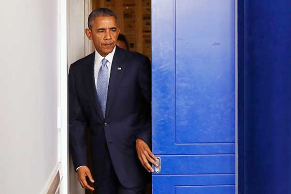 <div class='meta'><div class='origin-logo' data-origin='none'></div><span class='caption-text' data-credit='Jacquelyn Martin/AP Photo'>President Barack Obama enters the briefing room to speak about the Baton Rouge, La., shooting of police officers, Sunday, July 17, 2016.</span></div>
