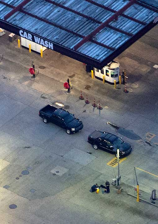 <div class='meta'><div class='origin-logo' data-origin='none'></div><span class='caption-text' data-credit='Gerald Herbert/AP Photo'>In this aerial photo, investigators work the shooting scene in Baton Rouge, La., where several law enforcement officers were either shot or killed, Sunday, July 17, 2016.</span></div>