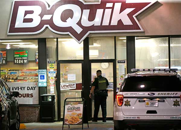 <div class='meta'><div class='origin-logo' data-origin='none'></div><span class='caption-text' data-credit='Gerald Herbert/AP Photo'>An East Baton Rouge Sheriff's officer enters the B-Quick convenience store at the shooting scene in Baton Rouge, La., where several law enforcement officers were shot.</span></div>