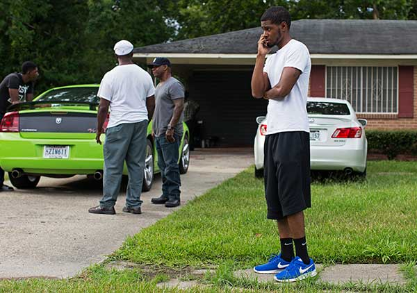 <div class='meta'><div class='origin-logo' data-origin='none'></div><span class='caption-text' data-credit='Max Becherer/AP Photo'>Kedrick Pitts, the half-brother of slain Baton Rouge Policeman, Cpl. Montrell Jackson, talks on the phone in front of Montrell's mother's house in Baton Rouge, La.</span></div>