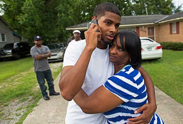 <div class='meta'><div class='origin-logo' data-origin='none'></div><span class='caption-text' data-credit='Max Becherer/AP Photo'>Beverly Blakes, the aunt of fallen Baton Rouge policeman Montrell Jackson, hugs Kedrick Pitts, the half-brother of slain Baton Rouge Policeman, Cpl. Jackson.</span></div>